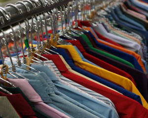 Various types of collared shirts hung up on a rack